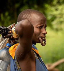 Mursi Woman (Rod Waddington) Tags: africa african afrique afrika äthiopien ethiopia ethiopian ethnic ethnicity etiopia ethiopie etiopian outdoor omovalley omo omoriver mago mursi tribe tribal traditional culture cultural candid woman village