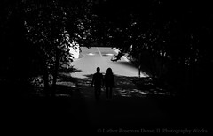 (Luther Roseman Dease, II) Tags: monochrome light shadows darkened depth framing contrejour silhouettes outdoors public streetphotography fotografie humanelement people