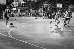 Late Night Game, Hong Kong (Geraint Rowland Photography) Tags: night nighttime city urban sports exercise athletes players basket basketball nighttimestreetphotographyinhongkong nightphotography highiso gritty blackandwhitephotography running moving focus geraintrowlandphotography wwwgeraintrowlandcouk igershongkong streetphotographyinhk
