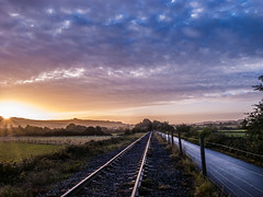 Track view sunflare (strangesimon) Tags: track trail explore sunrise sunflare countryside landscape england morning cycle path train tracks outside nature autumn clouds sky wildlife