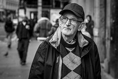 Let's Get Quizzical (Leanne Boulton) Tags: street streetphotography portrait people leanneboulton face urban candid portraiture candidstreetphotography streetportrait candidportrait streetlife old elderly man male eyes expression emotion mood feeling glasses cap baseballcap sweater autumn fall tone texture detail depthoffield bokeh naturallight outdoor light shade city scene human life living humanity society culture lifestyle canon canon5dmkiii 70mm ef2470mmf28liiusm black white blackwhite bw mono blackandwhite monochrome glasgow scotland uk