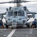 Sailors finish chocking and chaining an MH-60S Sea Hawk helicopter