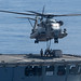 Marines attach cargo to a CH-53E Super Stallion on USNS Rappahannock during a replenishment-at-sea