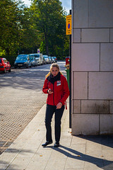 The girl in the red anorak (gwpics) Tags: upright england people clothes streetphotography southampton yellow uk red clothing editorial everydaylife hampshire hants lifestyle person society unitedkingdom vertical streetlife