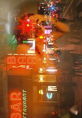 Beneath the dance hall lights (Sarah Rausch) Tags: nothemethursday filmswap 35mm tennesseevsnewyork countryvscity newyorkcity film ishootfilm shotonfilm filmisnotdead reflection self kodak burst ektar100 nyc newyork 8thave smith'sbarandrestaurant random doubleexposure minolta minoltaxe5 city girl tattoo night starburst