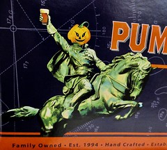 2019 Pumpkinhead Ale Beer - Sleepy Hollow Refugee Headless 5061 (Brechtbug) Tags: 2019 pumpkinhead ale beer sleepy hollow refugee headless carousel horseman bryant park behind new york public library october halloween night west side manhattan midtown 10092019 dummy costume mannequin ghost monster creature goblin wooden horse ride funhouse amusement jack o lantern pumpkin head cloak evening nite knight soldier hessian german holiday