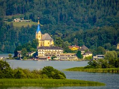 The island town of Maria Wörth on Lake Wörth in Carinthia, Austria. (catching image memories) Tags: carinthiaaustria carinthia austria lakewörth lake water mountains trees forests greensurroundings island