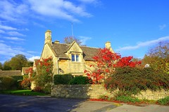 light and shadow (majka44) Tags: travel house building architecture fence road facade garden tree england bibury window grass green red roof sky blue cloud light shadow 2014 day leaves autumn village stone wall czphoto