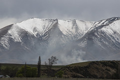 After spring snow (Ian@NZFlickr) Tags: maniototo spring snow hills mountains trees smoke otago nz
