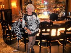 So Many Bottles; So Little Time (Laurette Victoria) Tags: bar hotel milwaukee woman laurette dress silver pfisterhotel fishnets