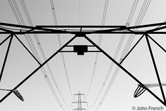 Silhouette of Electricity Pylons and Cables (John French 108) Tags: fordingbridge england unitedkingdom pylons monochrome leadinglines silhouette industrial electricity cables symmetry pattern wires