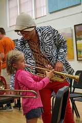 "The ""zoo keeper"" helps a student learn the trumpet • <a style=""font-size:0.8em;"" href=""http://www.flickr.com/photos/184953769@N08/48876415686/"" target=""_blank"">View on Flickr</a>"