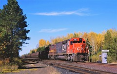 (SEE & HEAR)---CN, DMIR 401-416, Fairbanks, MN. 10-01-2006 (jackdk) Tags: train railroad railway locomotive emd emdsd40 emdsd402 emdsd40t2 sd40 sd402 sd40t2 tunnelmotor fallenflag standardcab dmir messabi duluthmessabiandironrange messabe ironore taconite south fairbanks fallcolor seeandhear seehear