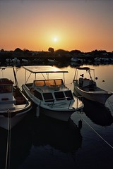Ride (michel nguie) Tags: sun portugal water vertical sunrise boats boat yacht aurora aurore aube fuseta fuzeta filmanalog orange