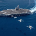 Multiple aircraft from Carrier Air Wing 5 fly in formation over USS Ronald Reagan