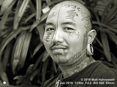 2013-11c Targeting Asia's Bold Menfolk (91) 2019 (02bw) (Matt Hahnewald) Tags: matthahnewaldphotography facingtheworld people character head face tattoo facialtattoo eyes lippiercing mouth ear earlobe earring piercing lips expression lookingatcamera moustache consent authenticity diversity humanity culture beauty art business fashion impact anthropology urban cultural inspiring city artist bangkok thailand asia asian thai person male adult young man men portraiture detail nikond610 nikkorafs85mmf18g 85mm 4x3ratio resized 1200x900pixels horizontal street portrait closeup headshot threequarterview outdoor posing incredible authentic monochrome blackandwhite mono bandicoot greyscale photoscape