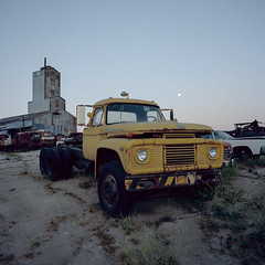 super duty. 2018. (eyetwist) Tags: eyetwistkevinballuff eyetwist ford superduty truck moonrise old yellow rusty mamiya 6mf kodak portra 160 mamiya6mf kodakportra160 50mm mamiya50mmf4l ishootfilm ishootkodak analog analogue film emulsion mamiya6 square 6x6 mediumformat 120 filmexif iconla lenstagger epsonv750pro mojave desert california sonorandesert highdesert derelict roadsideamerica americana typology dented rust dust dirt wasteland american west rural dusty trucks decay paintina abandoned junkyard work dusk