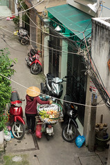ambulant fruit seller (kuuan) Tags: mf manualfocus penf zuiko penff1440mm 1440mm apsc sonynex5n saigon hcmc vietnam street seller fruit ambulantseller fruitstall district3 quan3 alley conicalhat motorbike