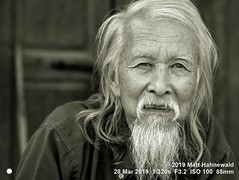 2013-11c Targeting Asia's Bold Menfolk (96) 2019 (07bw) (Matt Hahnewald) Tags: matthahnewaldphotography facingtheworld qualityphoto people character head face eyes scrutinizingeyes questioningeyes expression lookingcamera eyecontact beard consensual respect diversity humanity living travel tourism society lifestyle impact ethnic local urban oriental cultural loikow kayahstate myanmar burma asia asian person one male adult elderly man men portraiture detail nikond610 nikkorafs85mmf18g 85mm 4x3ratio resized 1200x900pixels horizontal street portrait closeup headshot fullfaceview outdoor posing authentic masculine rugged sceptical chinese sinoburmese longbeard longhair grey partinghair old blackandwhite mono monochrome greyscale bandicoot photoscape