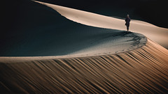 Lujon - A Warm Wind (ShutterJack) Tags: barren adventure alone arid california darkbackground deathvalley desert dry dune footsteps hike hiking journey oneperson path sand sole tracks trek vagabond walk walkabout