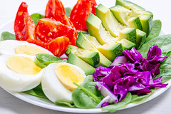 The concept of dietary nutrition. Boiled eggs with fresh vegetables (wuestenigel) Tags: egg natural boiled spinach slice background red chicken vegetarian meal protein organic yolk tomato lettuce cooking plate healthy food diet seeds salad nutrition closeup ingredient sesame raw cabbage concept purple green fresh vegan vegetable white 2019 2020 2021 2022 2023 2024 2025 2026 2027