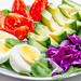 The concept of dietary nutrition. Boiled eggs with fresh vegetables