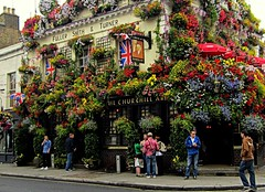 in front of the pub (majka44) Tags: london pub street england flower window facade nice people travel atmosphere building architecture umbrella red green blue road tourism