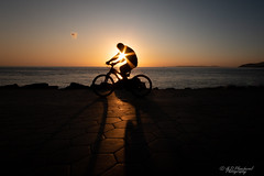 A solar cycle (Through_Urizen) Tags: art bicycle category erdek kapidag places seascape sunset transport turkey canon70d sigma1020 canon cycle cyclist sun sunstar silhouette coast water sea path road