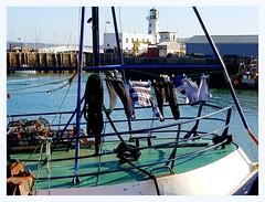 boat laundry (overthemoon) Tags: uk england northyorkshire scarborough northeastcoast seaside harbour lighthouse boat laundry