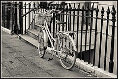 With a basket on the front. (tony allan tony allan) Tags: sepia mono monochrome bicycle bike railings pavement street streetphotography sonya6000 eludwigmeritar50mmlens manualfocus m42 legacyglass lens