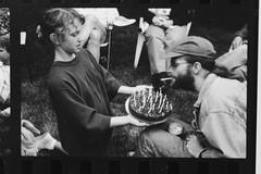 Andrew Taft's b-day party (Paul Comstock) Tags: andrewtaftsbdayparty 1995 chicago andytaft sarahtaft marytaftgarrison leavitt elizabethkozlowski may spring birthday birthdayparty f1 canon 35mm monochrome bw pauldaviscomstock may1995 cigarette birthdaycake zoetaft
