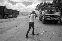 Here comes Mr NoPhotos ... (Rod Waddington) Tags: africa african afrique afrika uganda ugandan blackandwhite monochrome streetphotography truck trucks men candid border kenya marble nophotos security truckdriver driver business culture cultural