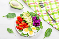 Top view healthy food background. Boiled eggs with fresh vegetables and spinach (wuestenigel) Tags: egg natural boiled purple slice background red chicken vegetarian meal protein organic yolk fork tomato lettuce cooking plate healthy food diet seeds salad nutrition closeup ingredient concept sesame raw cabbage spinach green fresh vegan vegetable white 2019 2020 2021 2022 2023 2024 2025 2026 2027