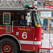 American Fireman in a red departement truck with ladder in Chicago