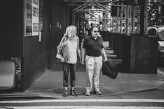 couple (Nun Nicer Artist) Tags: couple manhattan newyork citylife walking travel streetphotography people 35mmstreetphotography 35mm nunnicer monochrome blackandwhite bnw