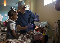 Medical staff aboard USNS Comfort (T-AH 20) treat patients in Basseterre, St. Kitts and Nevis.