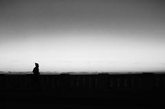 Running Man (natan_salinas) Tags: nikon clouds nubes mar sea cloudy paisaje landscape nube cielo sky bn blackandwhite monocromático valpo bw blackwhite blanconegro blancoynegro valparaíso ocaso atardecer arrebol sunset sunshine summer lateafternoon flush blush glow twilight crepúsculo contraluz backlighting backlight chile d5100 50mm monochrome gente look people city ciudad calle noiretblanc luz light shadow sombras silhouette silueta man hombre male