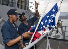 Sailors hoist the American flag aboard USS Normandy (CG 60). (Official U.S. Navy Imagery) Tags: deployment navy cruiser cg60 destroyersquadron28 desron28 ussnormandy c6f 6thfleet soudabay greece