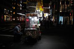 Food cart (Nun Nicer Artist) Tags: foodcart streetvendor vendor newyork night nunnicer nightphotography manhattan 35mmstreetphotography travel streetphotography street nyc food lights people