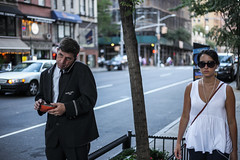 Attendant (Nun Nicer Artist) Tags: attendant manhattan nyc city citylife newyork 35mm 35mmstreetphotography streetphotography nunnicer travel walking phone people