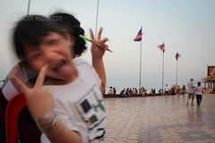 Girl Goofing Around Near Mother, Phnom Penh Riverside