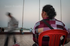 Woman Watches Passersby on the Riverside, Phnom Penh