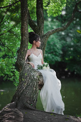 Beautiful bride with bouquet of flowers (Kovalchuk Igor) Tags: bride flower beautiful dress female beauty tree bouquet wedding person fashion white young happiness portrait woman outdoor happy girl love marriage nature bridal park asian day romantic alone model one attractive elegant cute floral spring summer glamour newlywed joy luxury pretty grass garden married elegance lady long smile smiling sitting