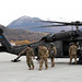 Alaska Army National Guard medics receive an Airman with a simulated injury during Polar Force 20-1