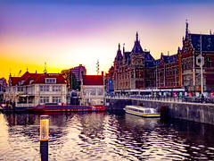Sunset over Amsterdam Centraal Station (Brian Katzberger) Tags: amsterdam amsterdamnetherlands amsterdamthenetherlands amsterdamcentraal amsterdamcentraalstation centraalstation trainstation nsrail nsrailways nederlandsespoorwegen nederland tram gvb canals dutch streetphotography