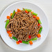 Top view buckwheat noodles with asparagus, carrots and sweet peppers on a white wooden background