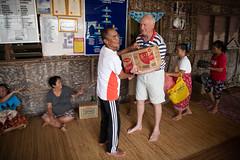 Handing over gifts to Iban Chief (Jim Nicholson) Tags: malaysia my borneo sarawak nikond850 nikon d850 nikkor2470mmf28