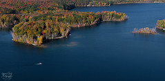 Boat on Thumb Lake, Michigan (Petoskey Drones) Tags: lake seascape trees fallcolors autumn aerial view drone photo