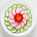 Fresh diet salad of cucumber, radish and tomato. Top view
