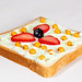 Sandwich with sea buckthorn berries, blueberries and strawberries